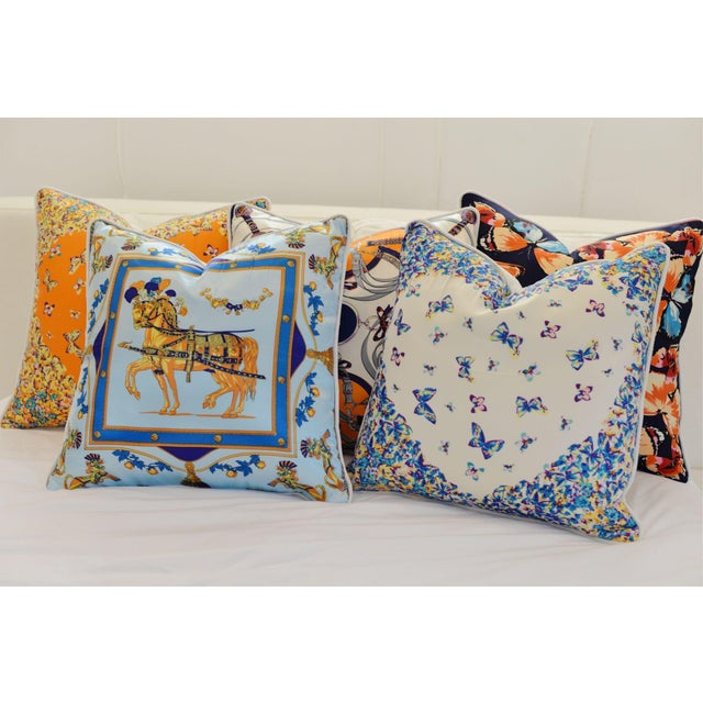 These luxe inspired pillows are your newest home accessory! Silk/Polyester scarfs backed with chic white ultra suede,...