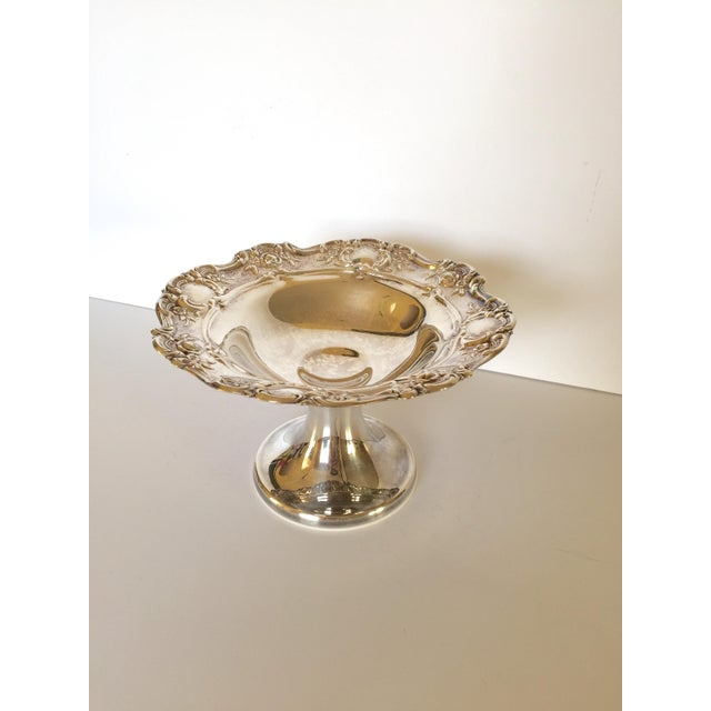 This beautiful silver pedestal bowl has a gorgeous alternating shield and rose design on the edge. It is in excellent...