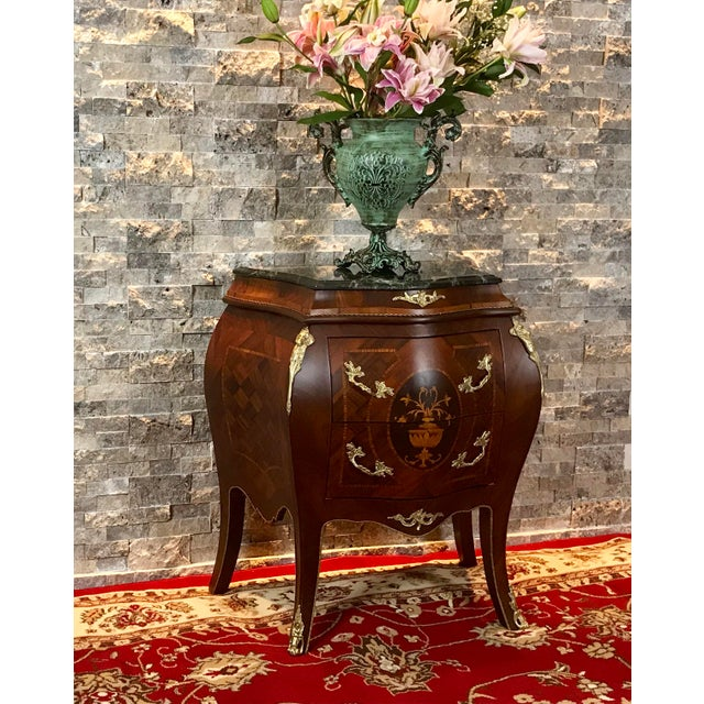Louis XV traditional beechwood with gold mounted petit side table with a marble top on capriole legs. This French Empire...
