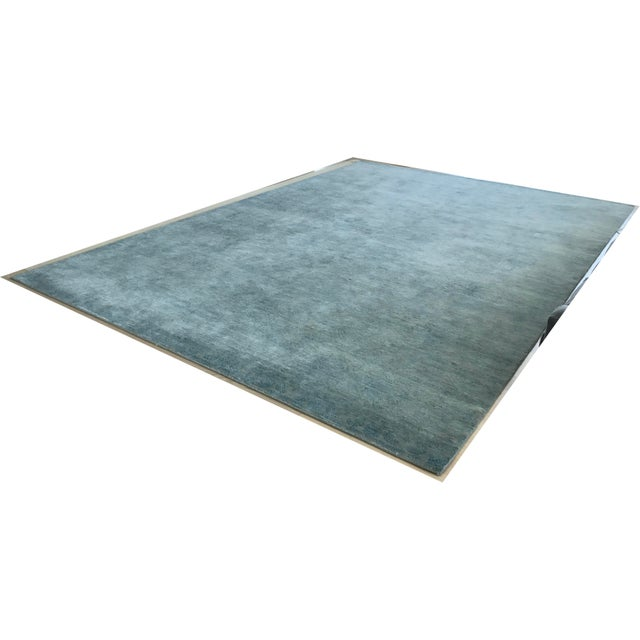 For sale is a hand knotted wool and real silk (not bamboo or viscose) rug that measure approximately 10' x 14'. Rug is...
