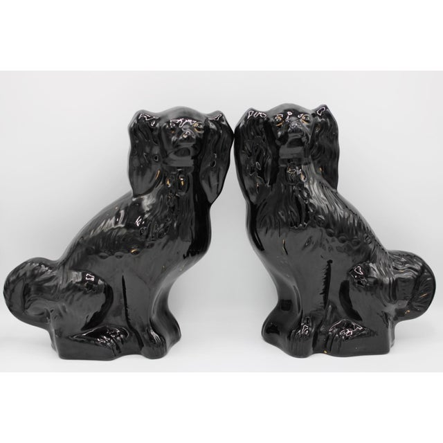 Antique English Staffordshire Jackfield King Charles Spaniel Mantel Dogs. Black with golden gilt accents, no maker's mark....