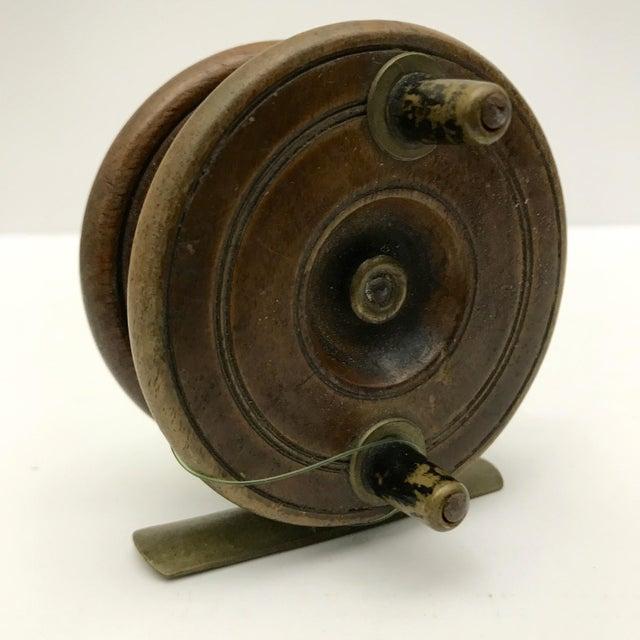 Antique English wooden fishing reel, C.1890.