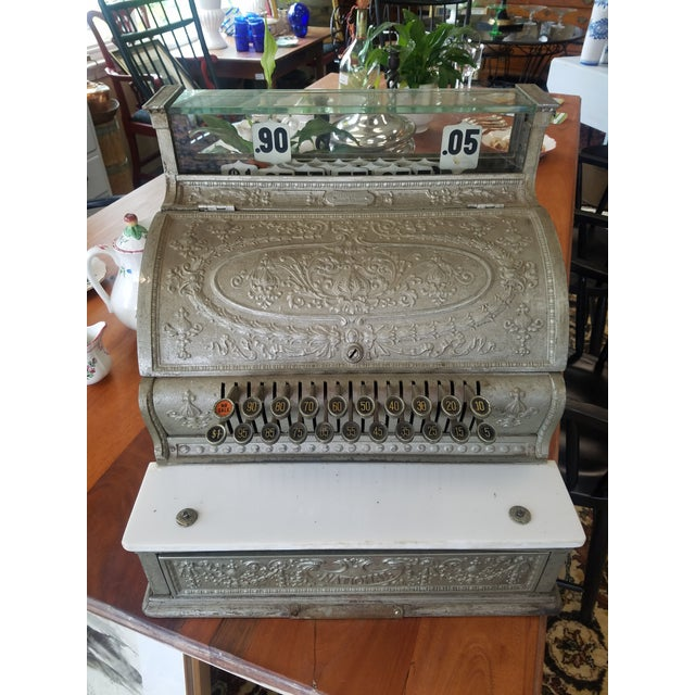 19th Century Cash register, with intricate foliate and floral cast reliefs. Galvanized finish.