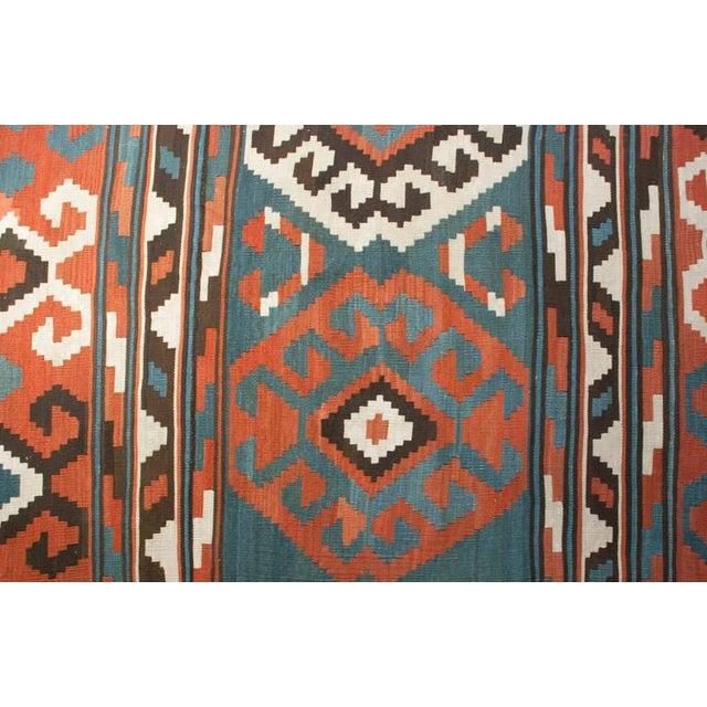 A 19th century Azerbaijani Kilim rug with an amazing alternating geometric striped pattern in crimson, emerald and cream,...