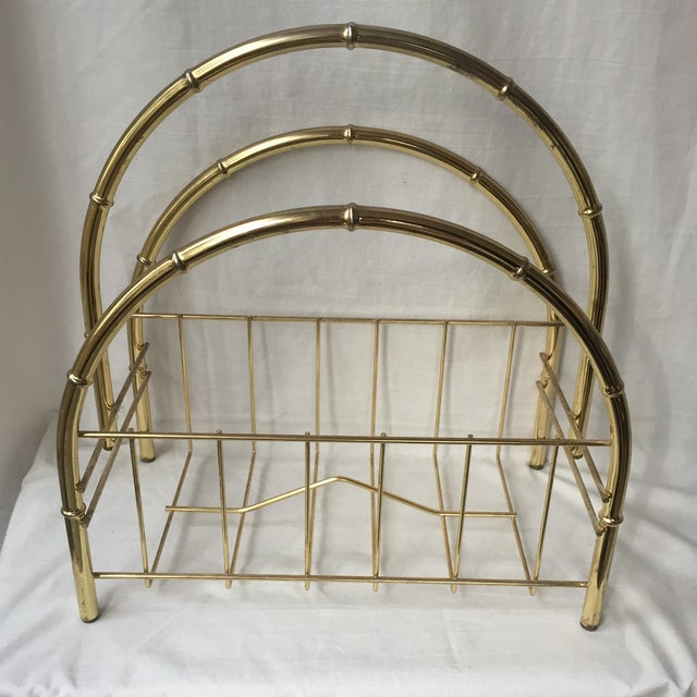 Beautiful brass magazine rack with three large bamboo motif arches. In excellent condition with minor wear.