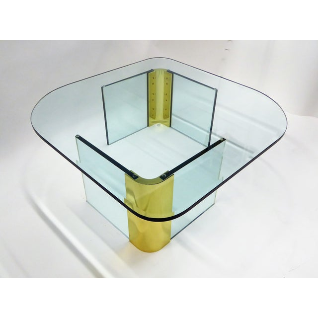 Fantastic thick glass and brass coffee cocktail table in the style of and attributed to the Pace Collection. The 3/4 inch...