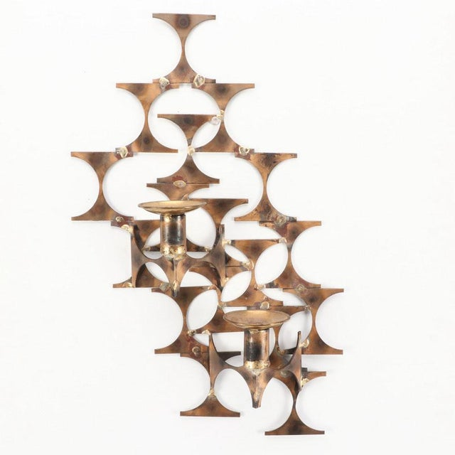 Modern style metal wall sconce sculpture, attributed to contemporary St. Louis artist and inventor Mark Weinstein who...