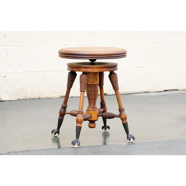 "Antique oak piano stool with a unique ""honeycomb"" spiral design and clawed glass ball feet. Solid wood, gently..."