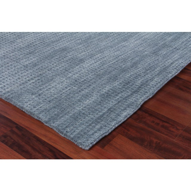 Incredibly soft and undeniably chic, the beautifully handwoven Worcester New Zealand Sheepskin rug adds a sense of...