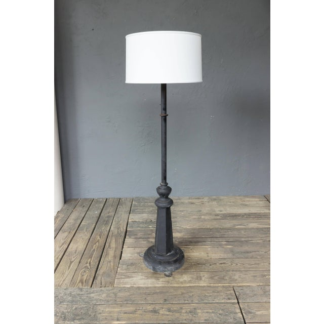 An unusual French floor lamp that was converted from a street or factory lamp. Made or metal and the base is heavy iron,...