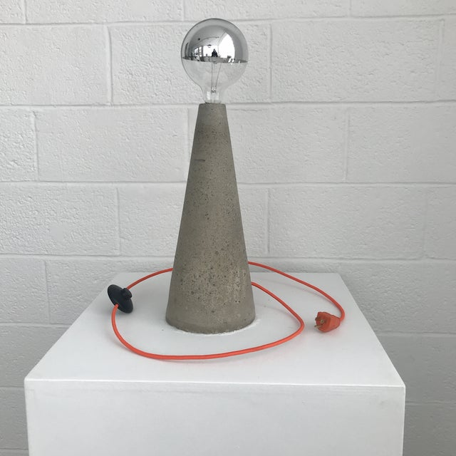 Tall Cone Light x Nicholas Tilma YEAR: 2018 MADE IN: Detroit, MI The Tall Cone light is made of hand-cast concrete with a...