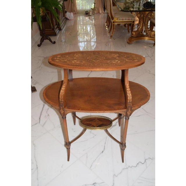 This is a very nice mahogany English Inlaid Three-Tiered Serving Table - Bottom tier has bronze gallery. Very good...