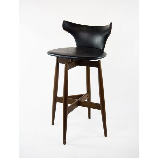 Add a little bit of ebony and ivory to the bar scene with this pair of Mid-Century Modern Kodawood bar stools. They...