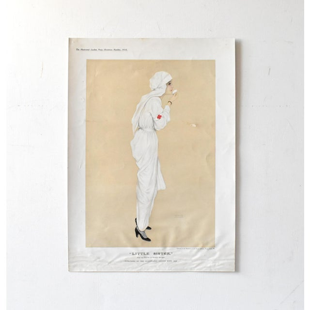 A vintage poster print of an original illustration by Raphael Kirchner of a WWI nurse dressed in white with a red cross...