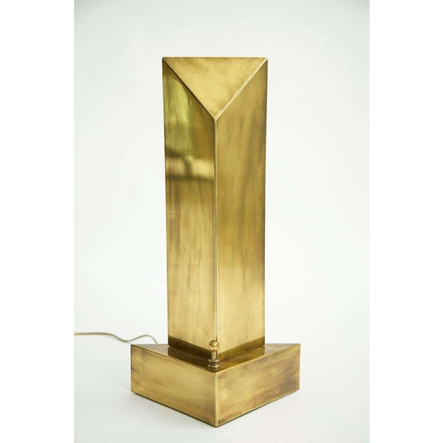HART ASSOCIATES Pair of Modernist backlit table torchres in patinated brass, with dimmer knobs, raised on triangular...