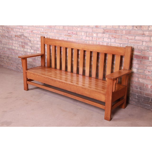 An exceptional Mission oak Arts & Crafts settle or bench In the manner of Stickley USA, Early 20th Century Measures:...