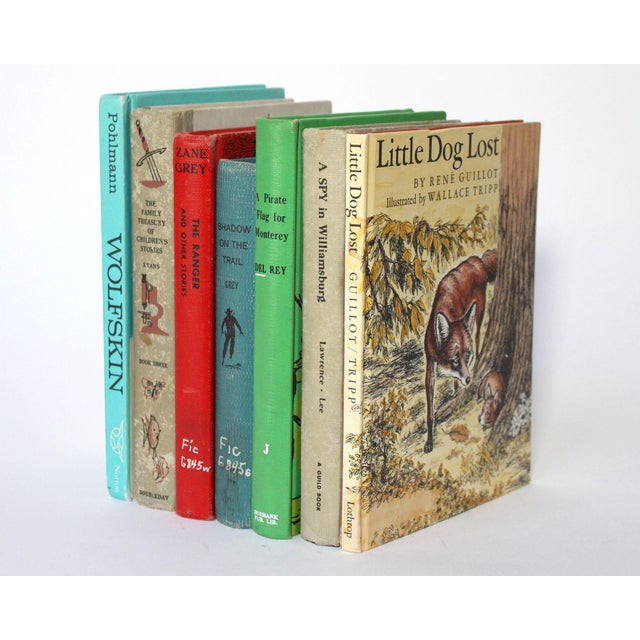 This bright collection of vintage books from the beginning to mid 20th century showcases 7 unique children's books and...