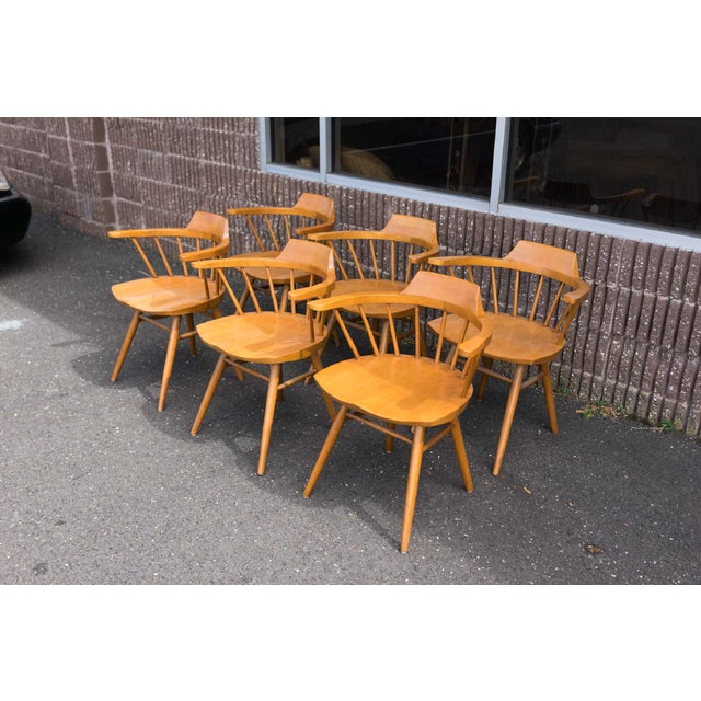 An accomplished set of six captain chairs from American midcentury craftsman George Nakashima.
