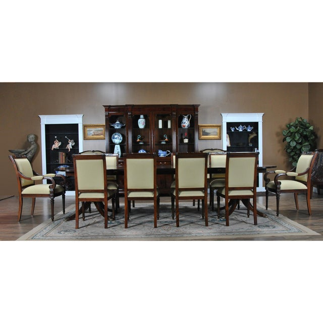 The Niagara Furniture Carved Empire Upholstered Arm Chair with carved top rail features a fully upholstered back which...