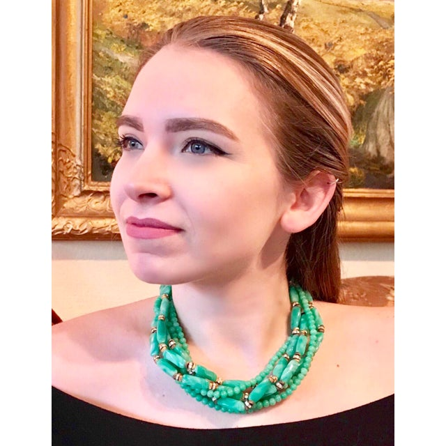 Circa 1960s William deLillo multi-strand, green glass bead necklace embellished with clear rhinestone roundels and gold...