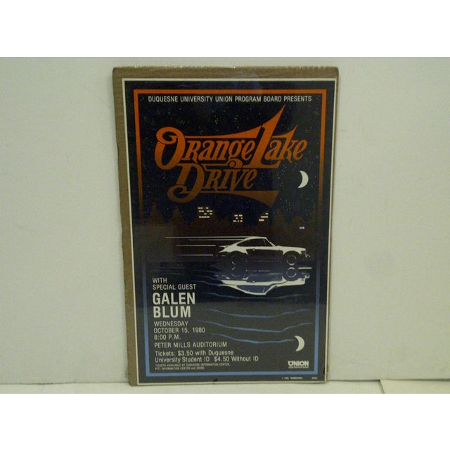 """A vintage concert poster of """"Orange Lake Drive"""" by O'Dell, October 15th, 1980."""