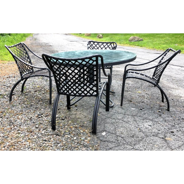 These have the curvy mid Century Modern look! Brown Jordan dining set, dark gray on dark gray. Glass table top. Use as is...