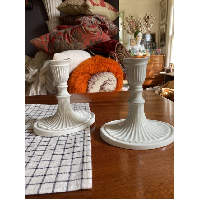 Very pretty lines in these vintage signed Italian candlesticks. Small chip on top of one. Enjoy!