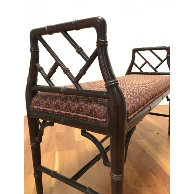 Carved faux bamboo fretwork of mahogany wood in the style of Thomas Chippendale. Finish is in good shape but with some...