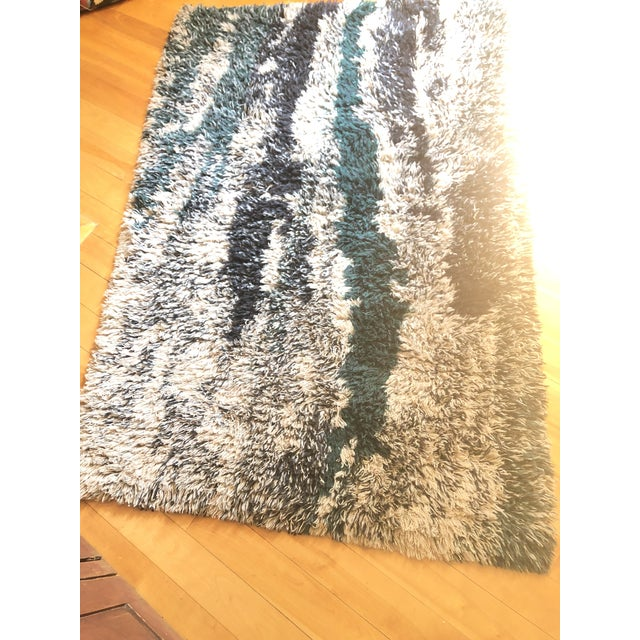 This stunning abstract vintage rug was well cared for and is in good condition, no stains ,snags or decay .It reminds us...