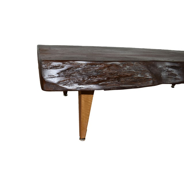 With the perfect combination of rustic/mid-century modern, this beautiful Anita Live Edge Coffee Table is sure to spark...