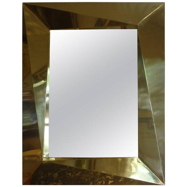 Interesting Italian brass Mid-Century Modern mirror with a 6 inch geometric border, circa 1980.