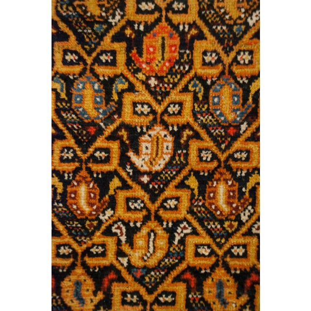 An early 20th century Persian Lori runner with a multi-colored paisley pattern with a brilliant gold latticework pattern,...