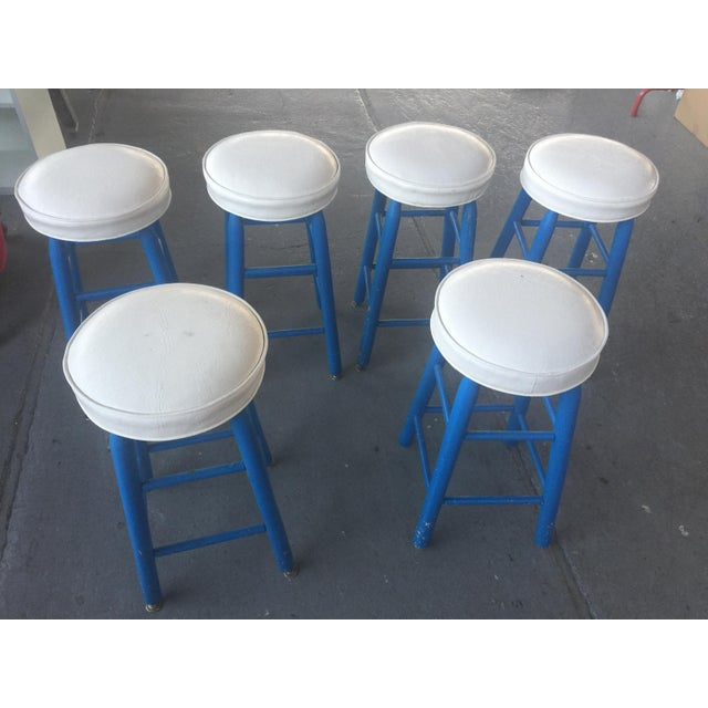 Set of six barstools , painted blue with white seats. Overall excellent condition, minor wear consistent with age and use....