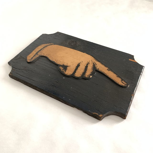 This very helpful hand points the way! Hand illustration with 'etched' effect mounted on black painted wood plaque. Notch...