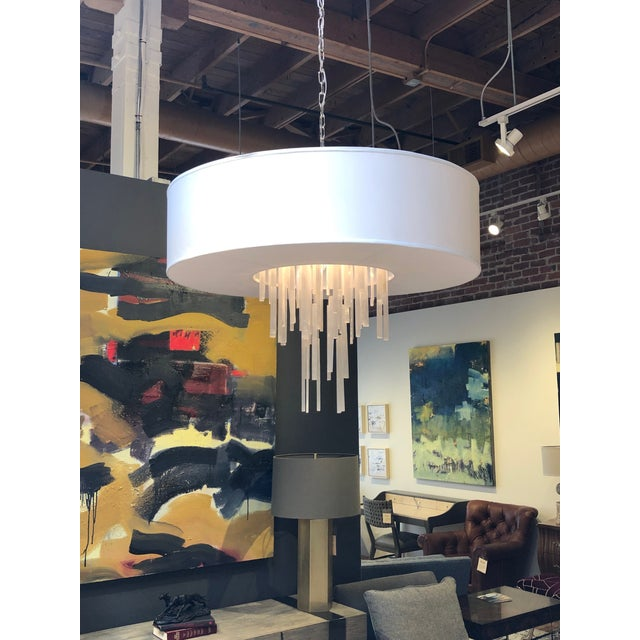 "Natural selenite strands drop and hang at varying heights from this seven-light pendant. Shade: 38"" X 38"" X 10"", Off..."