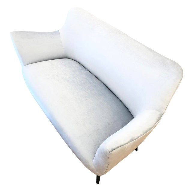 """Beautifully designed and balanced """"Perla"""" sofa by Guglielmo Veronesi for ISA from the 1950's. Its curved lines and tapered..."""