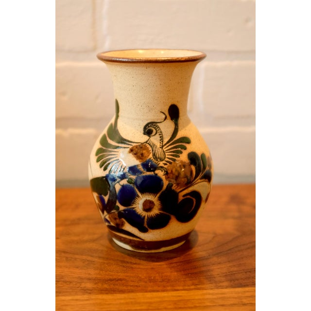 Studio pottery ceramic vessel with hand painted bird and floral motif. The piece is marked on the bottom. Date of...
