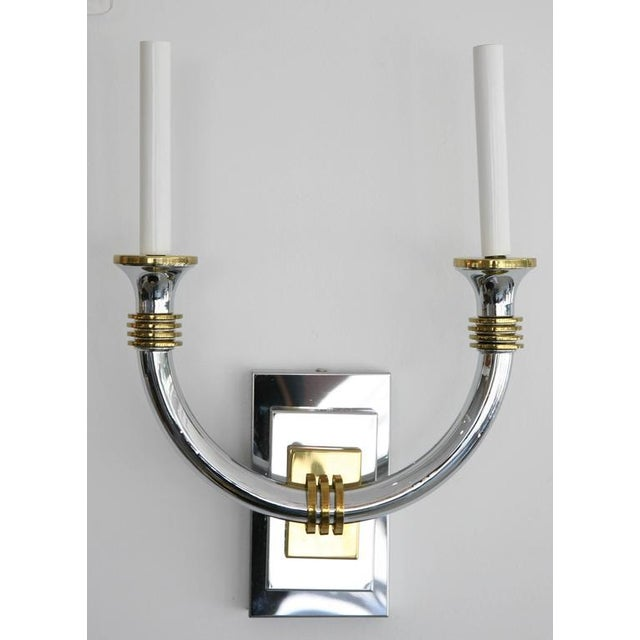 This handsome pair of wall sconces have taken the inspiration for the glamour of the Art Deco period and pieces that were...