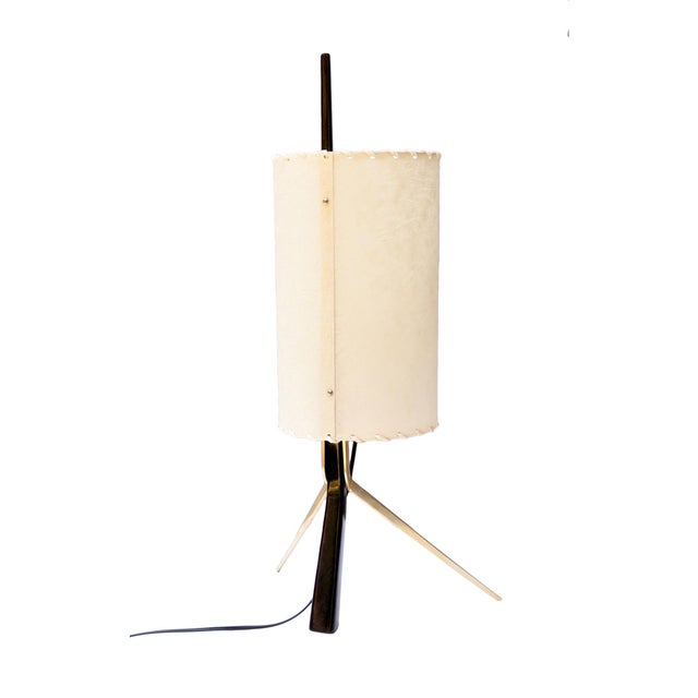 Nicely crafted table or desk lamp. The ebonized stem be handled for relocating the lamp from one spot to another as you...