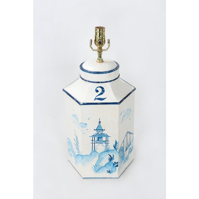 This vintage blue and white tole Hexagon tea caddy lamp depicts pavilions and cranes in an oriental landscape. No.2 pairs...