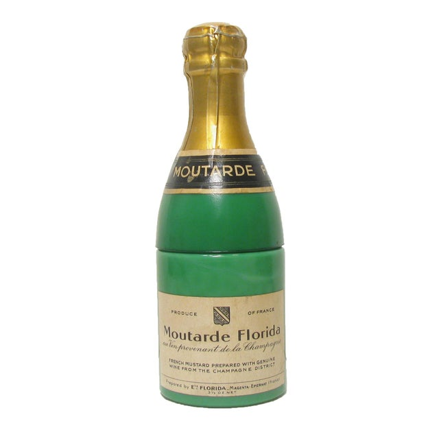 Vintage French green milk glass mustard jar in the shape of a champagne bottle discovered at an antique market in...