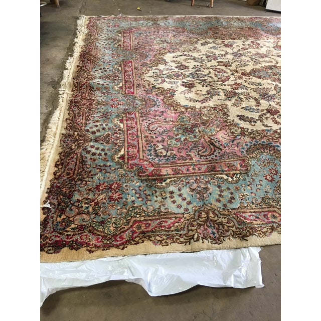 This is a semi antique Kerman persian rug from about 1940. The rug measures 12x18 is in good condition and has been...