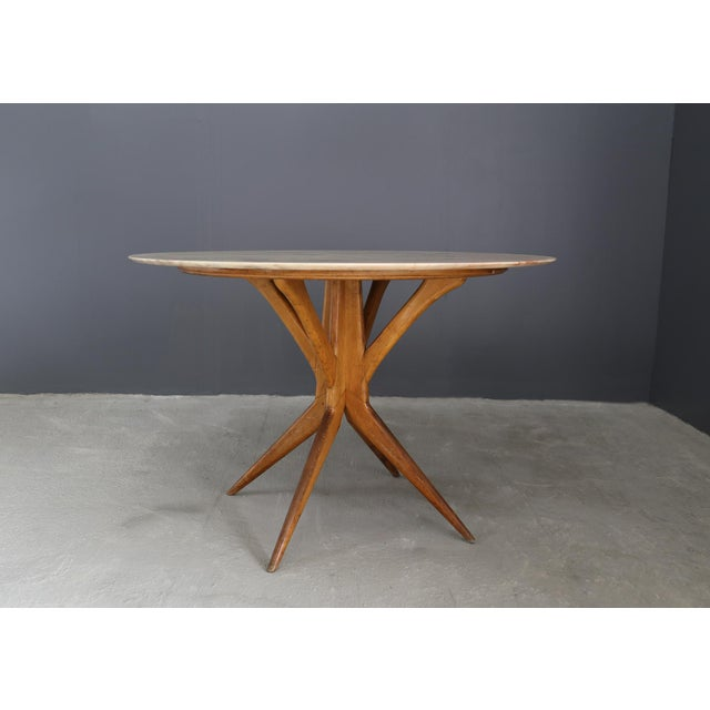 50's table attributed to BBPR. The table is made of marble and walnut, first patina, never restored, in perfect condition....
