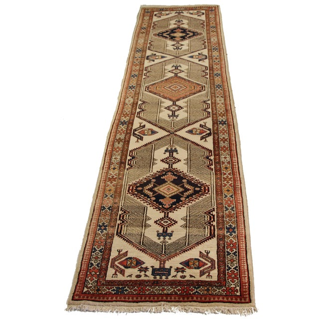 Antique Persian rug made of wool and bright natural dyes handwoven in the 1950s. It showcases a highly intricate tribal...