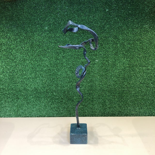 Fantastic 1980's freeform ribbon sculpture in bronze with a verdigris finish applied. Stamped J. Houston on base. Base...