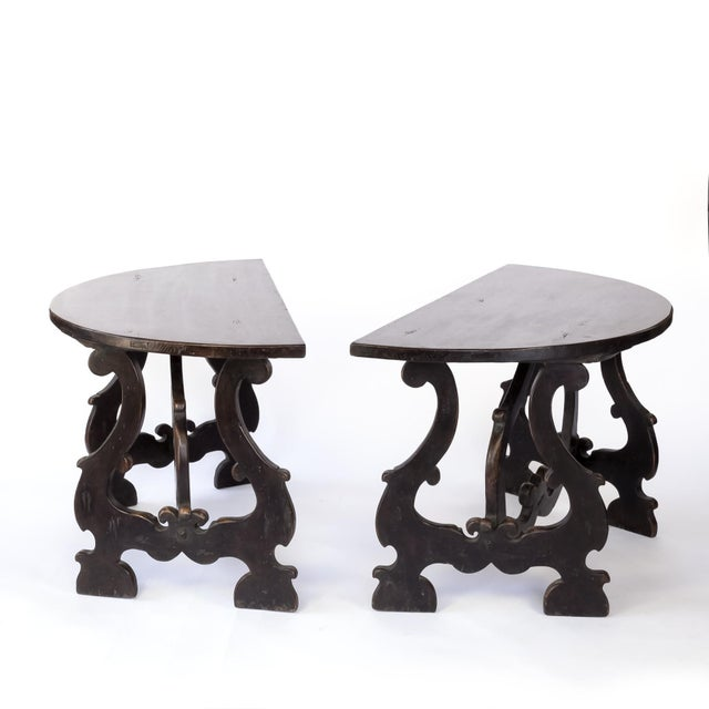 Pair of Late 17th century Spanish Baroque walnut demilune consoles with spreading harp shaped bases and walnut stretchers....