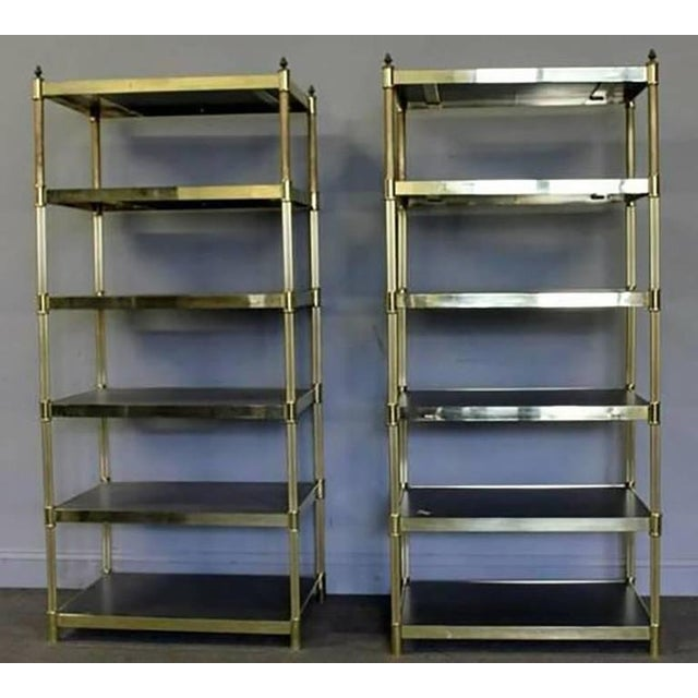 Pair of Hollywood Regency brass étagères. This elegant pair have lots of storage with its deep shelves. Six shelves total...