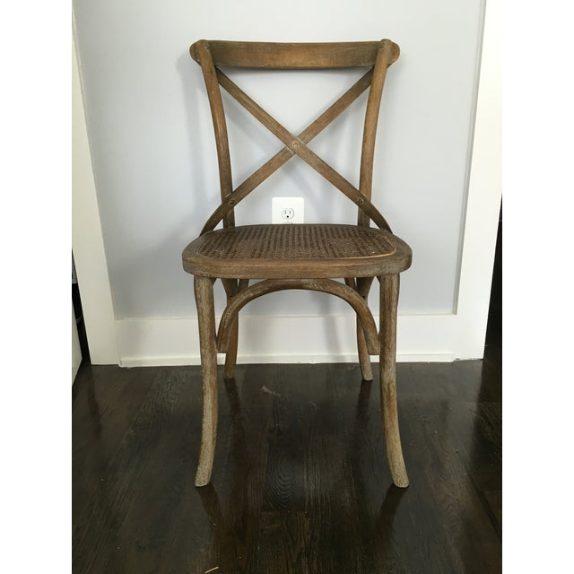 """From Restoration Hardware: """"Modeled after the most popular café chair in Europe, the versatile X-back dining chair pays..."""