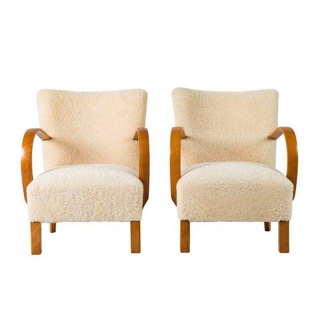 Pair of Scandinavian sheepskin lounge chairs.