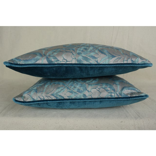 Pair of custom pillows made with Persepolis patterned Fortuny textile fronts in blue/green and silvery gold. Striking blue...